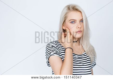 girl with beautiful white dyed hair isolated on grey background. Teenage woman with clean skin and silver color hair. Beauty concept