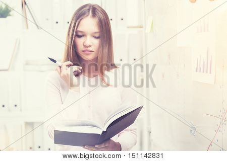 Beatiful Office Worker With A Book