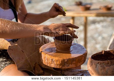 Potter Hands Making In Clay On Pottery Wheel.  Makes  The    Pot.
