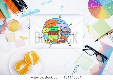 Creative colorful sketch on white office desktop with various items. Education concept