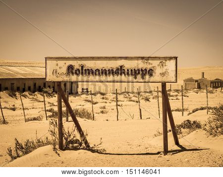 Kolmanskuppe, aka Kolmanskop, train station sign. Notice of old ghost diamond mining town of Kolmanskop near Luderitz in souther Namibia, Africa