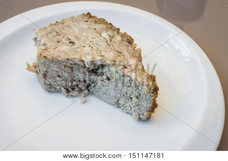 piece rabbit pate in a white plate on the table
