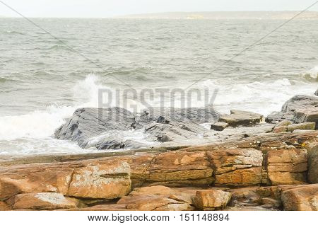 rocky coast with stormy waves in sweden