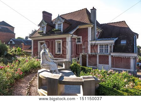House in Lisieux where she lived St. Therese of the Child Jesus before joining Carmel. The garden statue of St. Teresa and St. Louis Martin her father.
