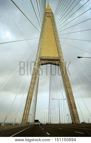 Suspension bridge across the River with car traffic.