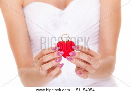 Engagement ring box in bride hands. Closeup of woman palms holding jewellery.