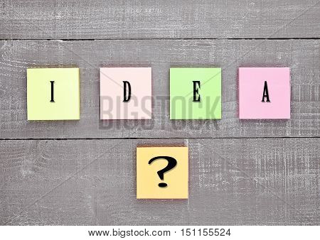 Blank different colors sticky note paper idea sign on wooden table