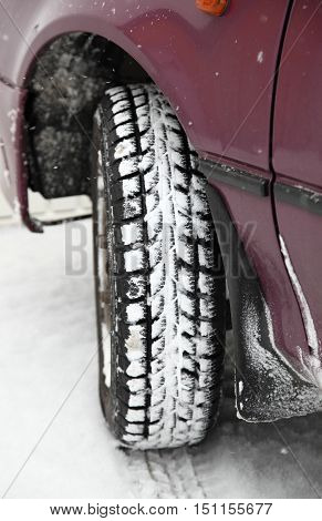 Detail of winter tyre of lilac car