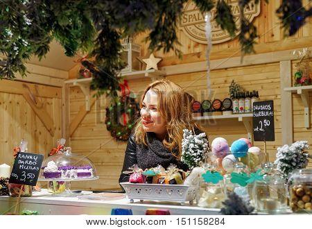 Woman Selling Handmade Soap At Vilnius Christmas Market Lithuania
