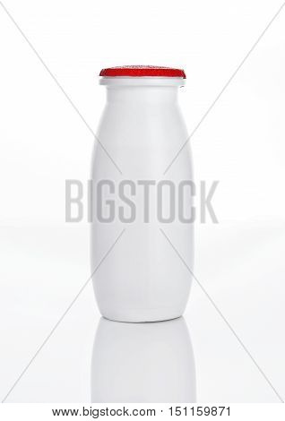Yogurt container healthy vitamin drink on white background