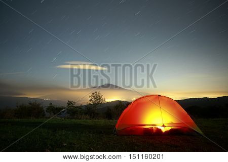 Lighting tent, Etna Mount, cloud formation and stars trails, Sicily