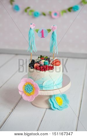 Blue cake with berries on the cake stand