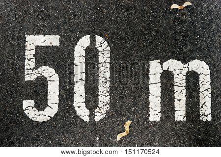 50 meters on black city asphalt on floor