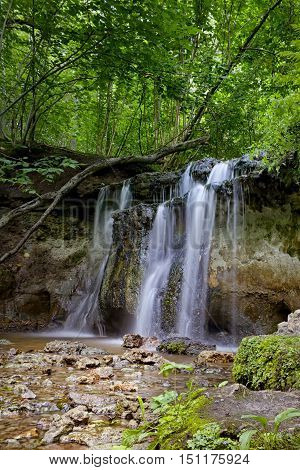 Daudas waterfall/2.3 m high waterfall has developed at the place where the dolomite scarpe from Pļaviņu suite and the yellowish-white ball-shaped sandstone from Amata suite meet.