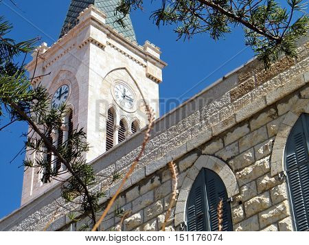The tower with clock of St. Anthony's Church in old city Jaffa Israel March 14 2011