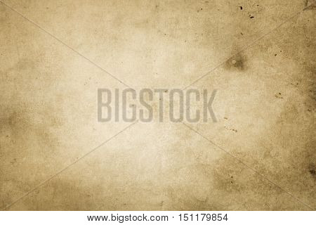 Aged dirty yellowed paper texture for the design.Abstract vintage paper background.