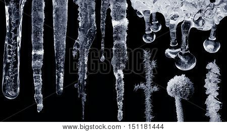 Set of icicles and frost on black background