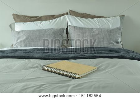 Notebook On Bed With Gray Color Scheme Bedding