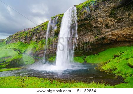 Seljalandsfoss in Iceland the waterfalls that the visitors can walk behind it into a small cave