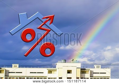 Red percent sign on the background of the house and rainbow .The concept of reducing property prices .