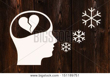 Paper head with broken heart inside. Love concept. Abstract conceptual image