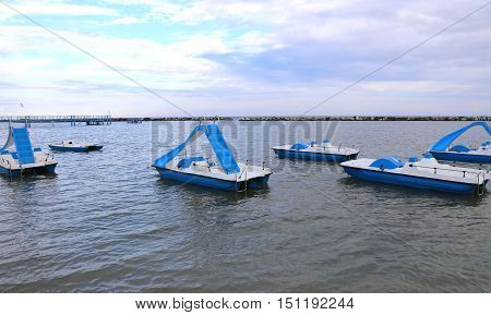 many pedal boats in the sea in summer