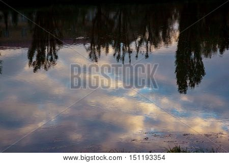 Idyllic scenery of sky reflected in the river sky river reflection of clouds and trees