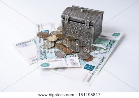 Decorative chest stands on the banknotes and small coins