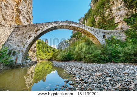 One-arch stone bridge of Noutsos (or Kokkoris) on the river of Voidomatis near the villages of Koukouli in the Central Zagori. Greece