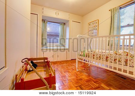 Baby Room With Crip And Window Seat