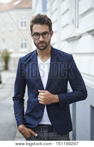 Suave man in suit jacket portrait - in town