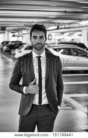 Sharply dressed man in parking lot portrait