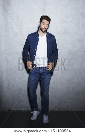 Man in blue shirt and jeans portrait