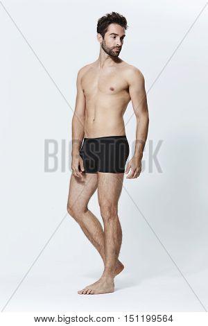Guy in shorts against white background - studio