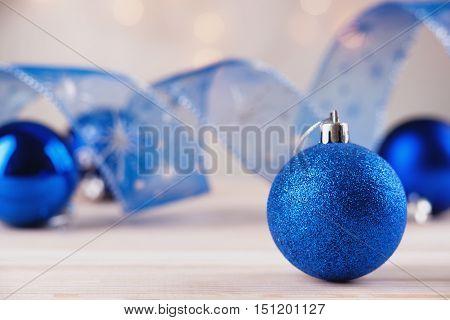 Photography of a blue chrismas balls and ribbon