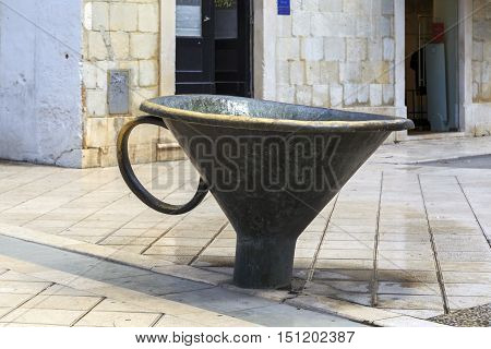 SPLIT, CROATIA - SEPTEMBER 11, 2016: This enormous funnel is part of the contemporary of the fountain in the center of the city.