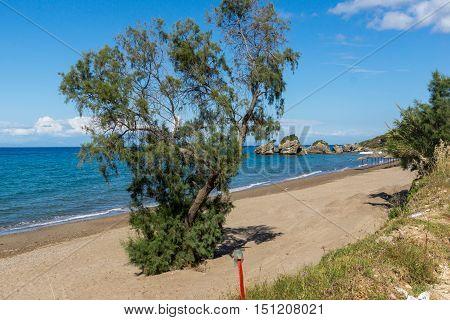 Rocks in the water of Porto Kaminia beach, Zakynthos island, Greece