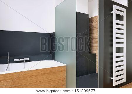 Bathtub And Shower In Tiled Bathroom