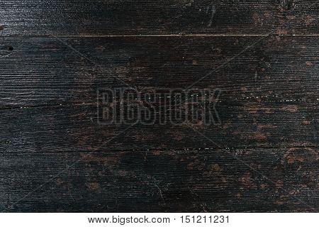 Textural image: mahogany black surface of wooden board