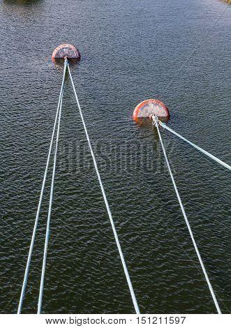 Many Ropes to Mooring Anchors in Harbor
