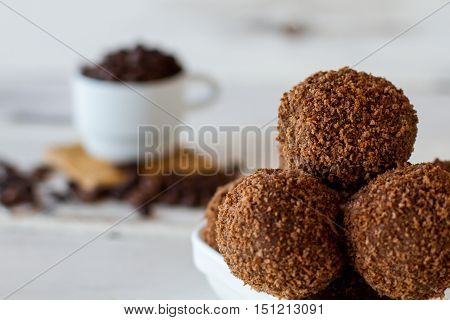 Brown ball shaped desserts. Candies with crumbs. Cookies and sugar. Sweet dish from russian cuisine.
