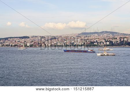 barge floating along the shores of the Bosphorus in Istanbul