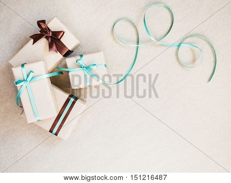 Christmas background with gift boxes wrapped in kraft paper
