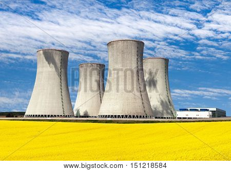 Nuclear power plant Dukovany with golden flowering field of rapeseed - Czech Republic - two possibility for production of energy