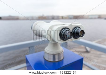 tourist binoculars at Peter-Pavel Fortress. with a view of St. Petersburg