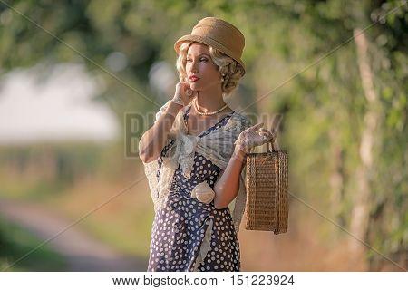 1930S Retro Fashion Woman Standing With Handbag On Rural Pathway.