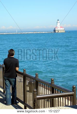 Pier Man And Lighthouse
