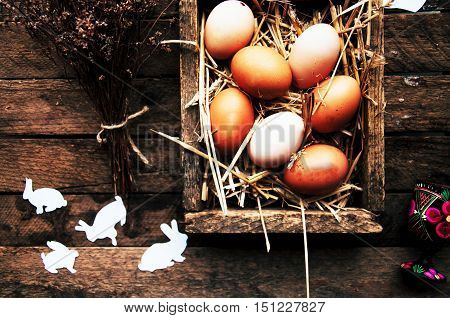 Easter Composition With Chicken Eggs On The Warm Wooden Backgrou