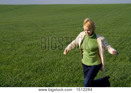 Woman Rushing Through Spring Field