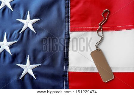 Soldier's token on American flag background